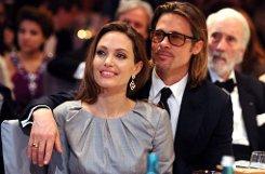 b2012:/b Ganz Berlin im Brangelina-Fieber. Angelina Jolie präsentiert auf der Berlinale ihr Balkankriegs-Drama In the Land of Blood and Honey - im Hintergrund hält sich ihr Lebensgefährte Brad Pitt. Foto: dpa