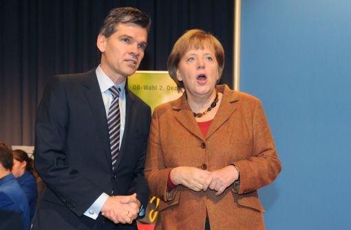 Bundeskanzlerin Angela Merkel (CDU) und Ingo Wellenreuther (CDU), Kandidat für die Oberbürgermeisterwahl in Karlsruhe Foto: dpa
